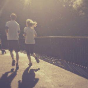 People jogging over a bridge